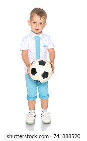 Cute boy ,  holding ball, isolated portrait of a preteen smiling and having fun, kids activities, little footballer.Isolated on white background.
