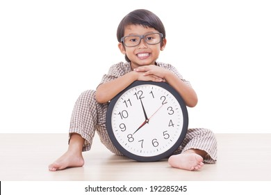 Cute boy is holding big clock isolated on white background