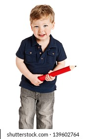 Cute boy holding a big pencil looking happy on a studio white background.