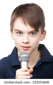 Cute boy holding microphone on white background