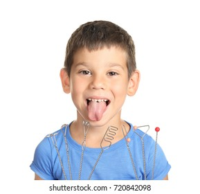Cute boy with logopedic probes for speech correction on white background