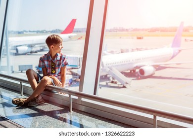Cute boy looking at planes in the airport