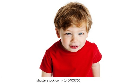 Cute boy looking up, wearing a red T-Shirt in a studio on a white background.