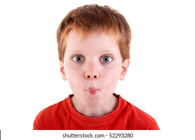 """cute boy making """"funny face"""", isolated on white background. Studio shot."""
