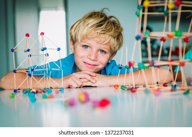 cute boy making geometric shapes, engineering and STEM