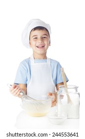 Cute boy mixes ingredients for sponge cake
