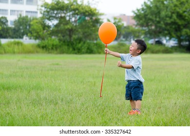 Cute boy play with balloon at outdoor
