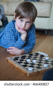 cute boy playing checkers