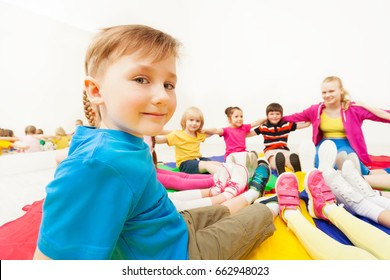 Cute boy playing circle games with friends in gym