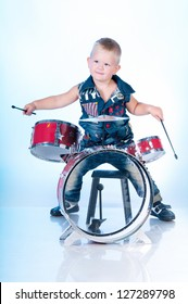 Cute boy playing the drums