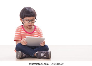 Cute boy playing a game on computer tablet