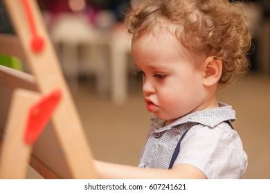 Cute boy playing in the nursery