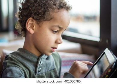 Cute boy playing with tablet - Kid with tablet - Little boy with tablet pc computer at home