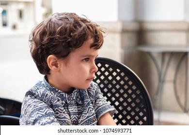 Cute boy profile outdoor portrait.
