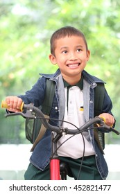 Cute boy ride a bicycle