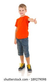 cute boy showing thumb up gesture on white background