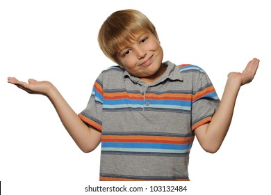 Cute Boy Shrugging on White Background. Elementary school age boy shrugging while smiling on a white background.
