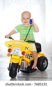 Cute boy sitting on motorcycle. At window background