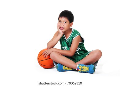 cute boy sitting and relaxing on the floor.white background.
