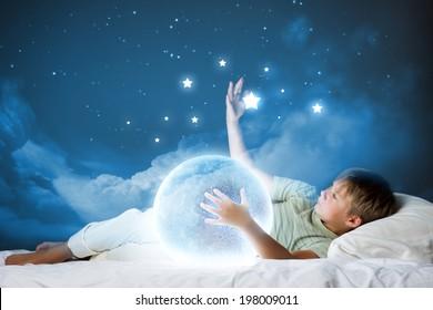 Cute boy sleeping in bed with moon