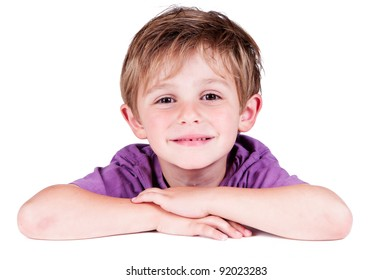 cute boy smiling in a studio hanging on a table