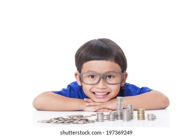 Cute boy with a stack of coins