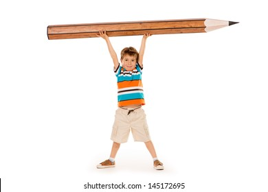 Cute boy standing with a huge pencil. Education. Isolated over white.