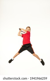 Cute boy with tennis racket jumping against white background