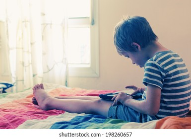 Cute boy using a laptop