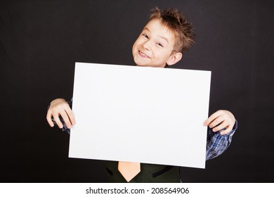 Cute boy with white empty banner against the black