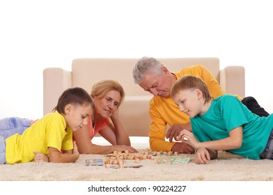 cute boys with grandparents playing on carpet