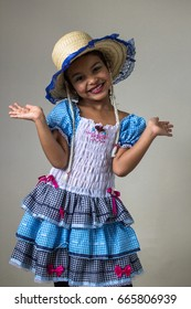 Cute brazilian kid  wearing traditional costume for Junina Party