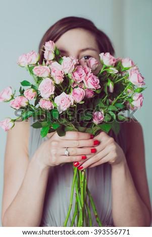 cute bridesmaid hiding behind bouquet rose stock photo edit now