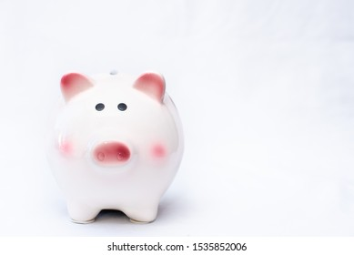 cute bright white and pink piggy bank against horizontal clear clean white background with room for text