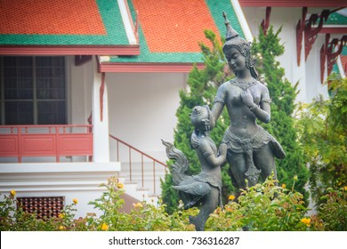 Cute bronze mother and son kinnaree sculptures in the green garden at Bhubing palace, Chiang Mai, Thailand. Kinnari or kinnaree is depicted as woman wearing an angel-like costume and similar to a bird
