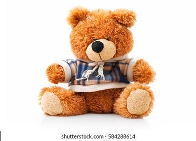 Cute brown Teddy bear with sweater. Isolated on white background with shadow reflection. Brown teddie sitting on white underlay. Darling little shaggy gift for girlfriend.