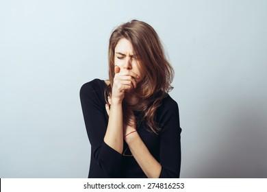 cute brunette girl in a fist coughs