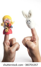 Cute bunny rabbit and a girl finger puppet isolated on white background.