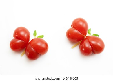Cute butterflies made of tomatoes and basil leaves.