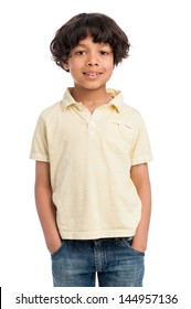 Cute casual mixed race afro caribbean boy standing isolated in studio white background and yellow tee shirt.