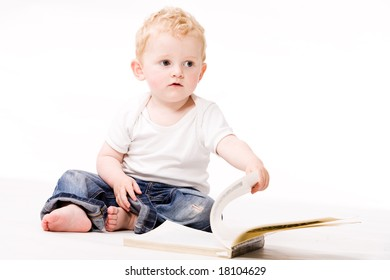 Cute caucasian blond toddler is happy and playfull