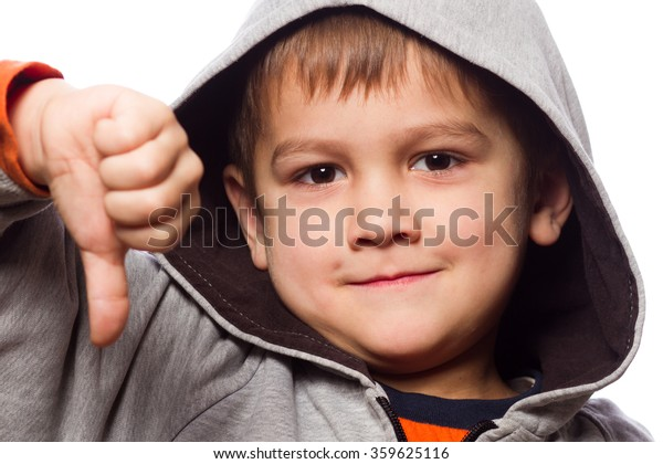 cute caucasian boy wearing hooded sweatshirt and show his hand vote down - isolated