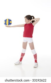 Cute Caucasian girl serving the ball in volleyball isolated on a white background