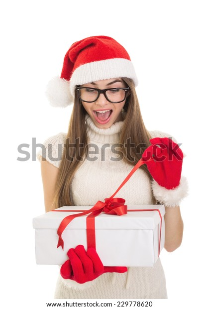 Cute Christmas Gifts For Teenage Girls.Cute Caucasian Santa Teenage Girl Eyeglasses Stock Photo