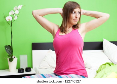 Cute caucasian woman stretching in bed