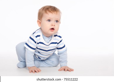 Cute charming baby sitting on the floor