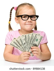 Cute cheerful little girl with paper money - dollars, isolated over white