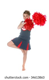 cute cheerleader balancing on one leg with red pompoms