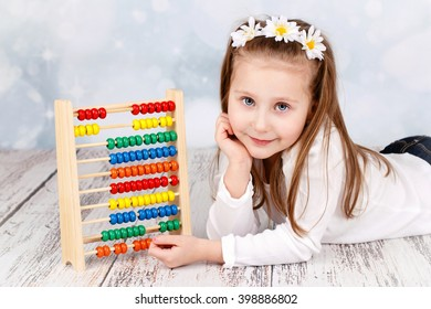 Cute child with abacus