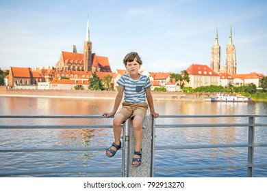 A cute child against Ostrow Tumski in Wroclaw, Poland